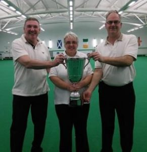 Triples Champions: Clive & Bernice McGreal with Mike Cain