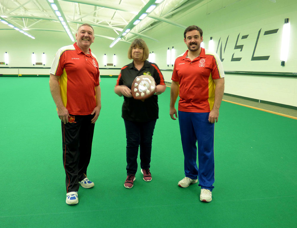 Dragon pairing of Clive and Mark McGreal, with the IOMIBA president and the Pairs trophy