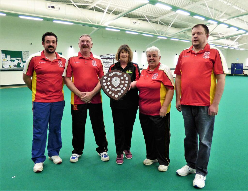 The Dragons, winners of the premier team league, pictured with IOMIBA President, Win Kewley